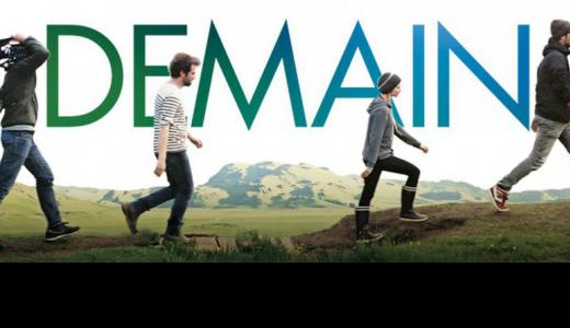The movie poster shows seven figures holding video equipment walking across a landscape in front of the word 'Demain' (French for 'Tomorrow')